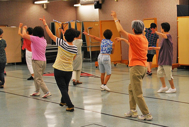group of older adults in a dance fitness class