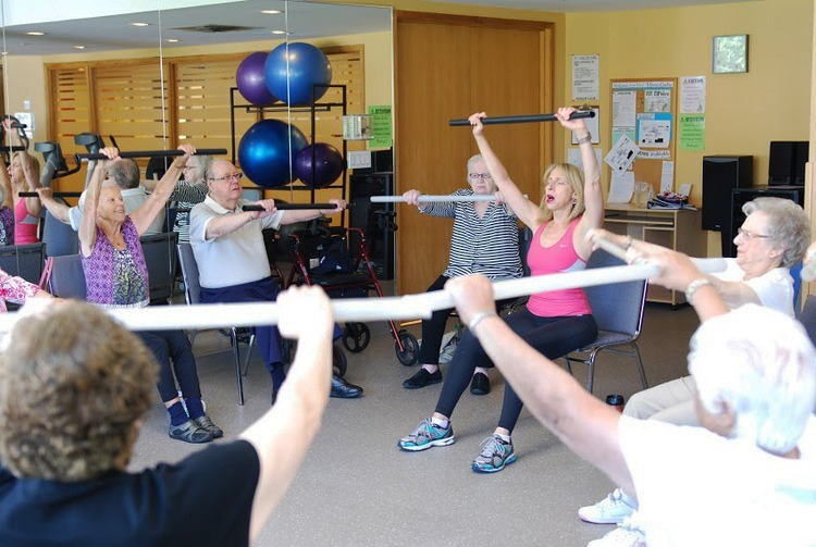 group of older adults in a seated fitness class