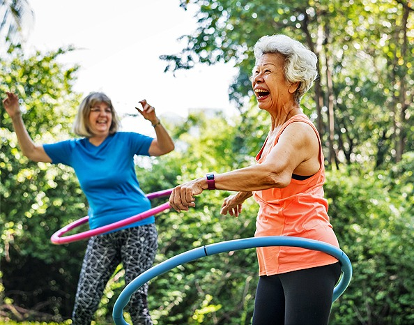 older women having fun with hoola hoop