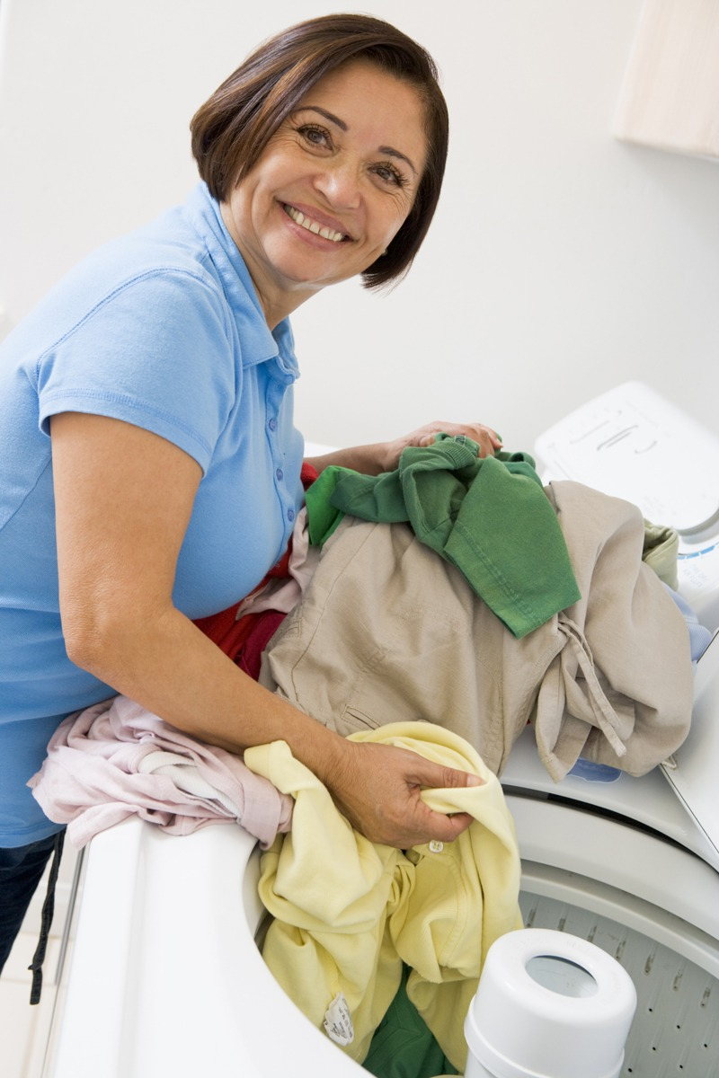 care worker doing laundry