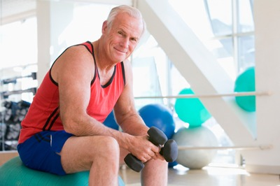senior man working out at gym
