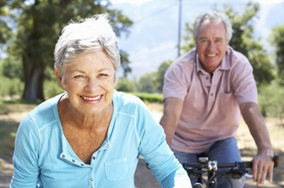 older happy seniors riding bicycles