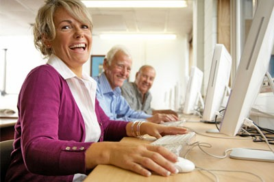 older adults working on computers